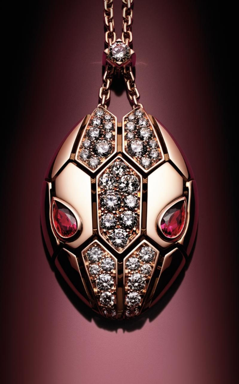 Bulgari Serpenti pendant in rose gold with diamonds and rubies Credit: Guido Mocafico