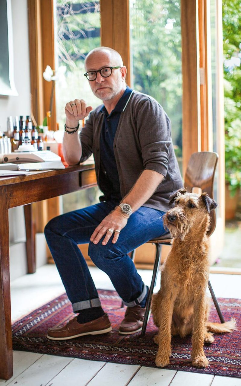 Perfumer Paul Schütze in his studio with his Irish Terrier, Gilbert Credit: Jack Latham