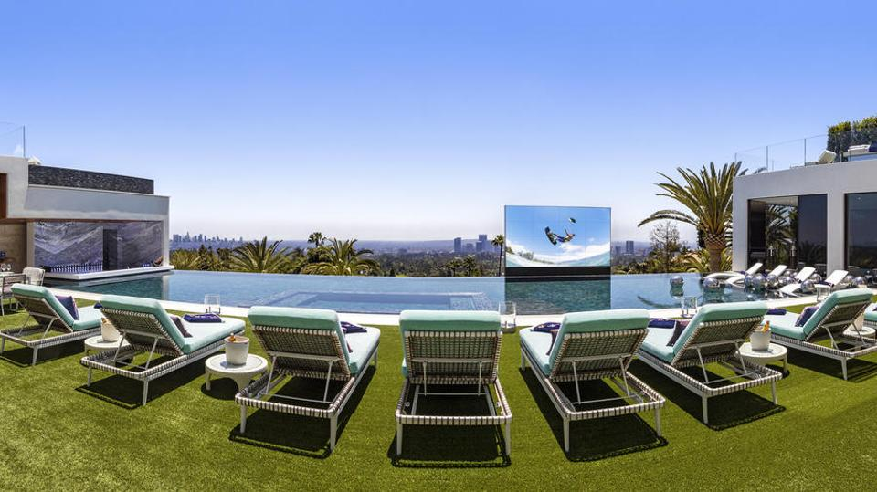 Makowsky likes to measure his TVs by feet--so this 18-foot-wide hydraulic screen rises over the pool and costs $2 million alone.