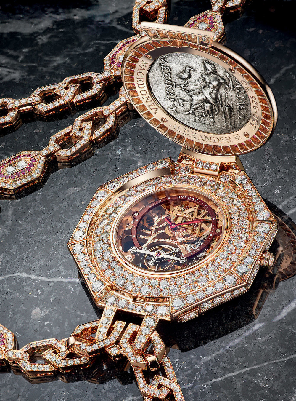 The gorgeous tourbillon calibre of the Bulgari Monete Pendant watch is itself protected by an octagonal case forming the pendant, crafted in 18kt pink gold and set with diamonds and rubies.