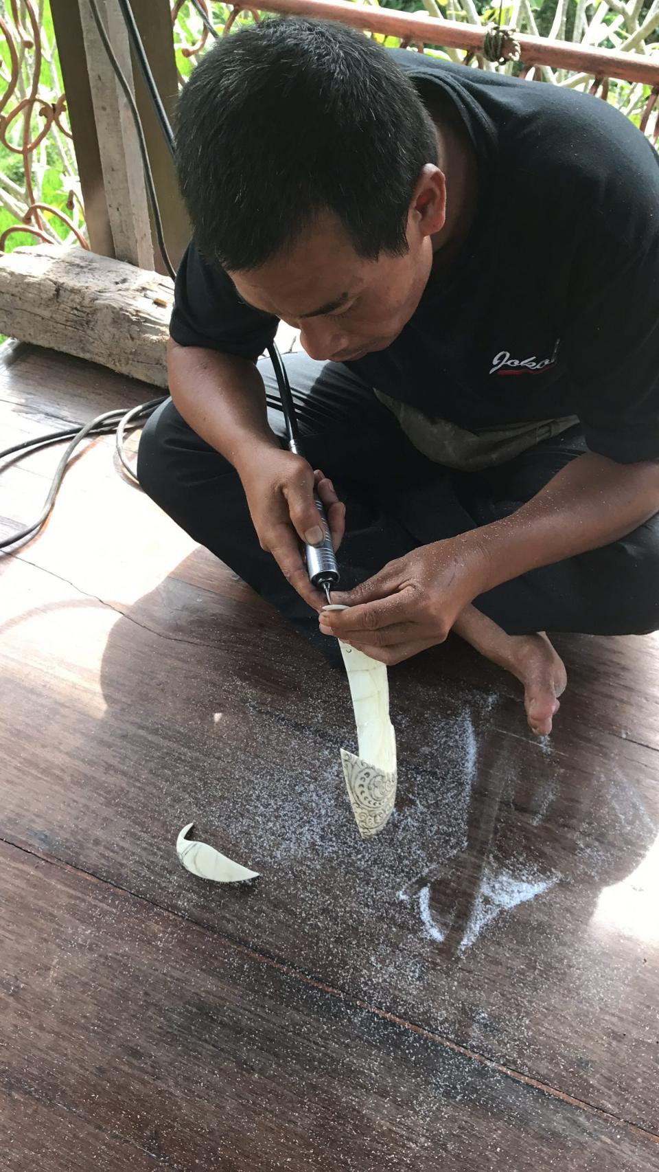A Balinese craftsman working with Tagua for a Bali-inspired jewel