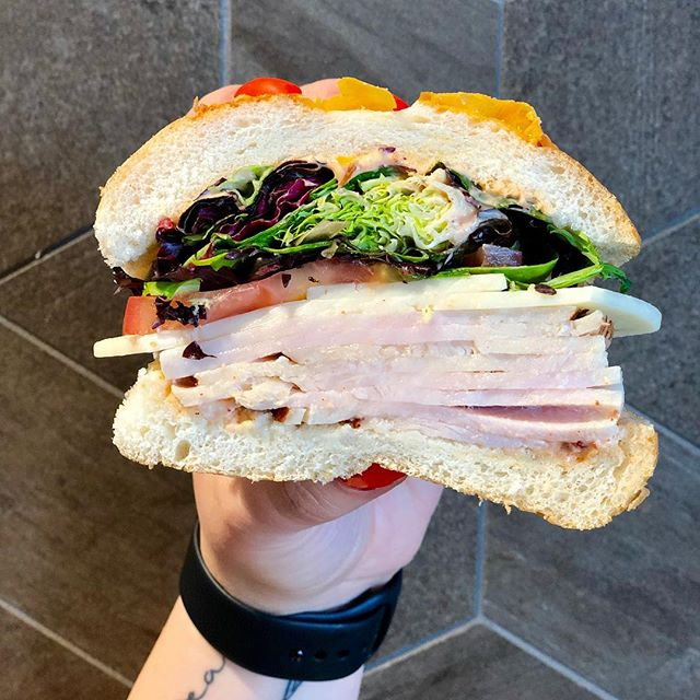 Open wide!! Our Chipotle Turkey is stacked with fresh sliced turkey breast, pepper jack cheese and fresh veggies, all on our fresh baked artisan cheddar bread. This sandwich is sure to make your officemates have lunch envy!#foodevanwa #foodecafe #foodecafecatering #foodecaters #discovervanusa #vanwa #vanusa #fromscratchdaily #madewithlove  Hand Model - @halleyriggs 💕