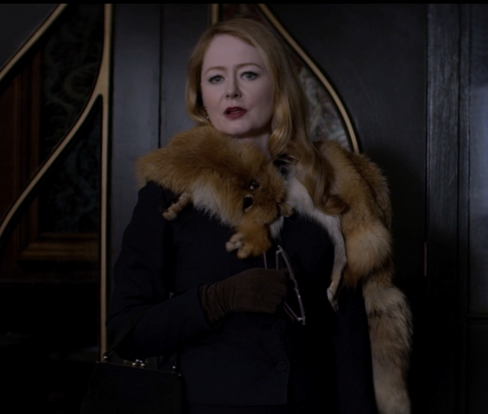 Aunt Zelda prepares to visit the high priest in a fox stole.