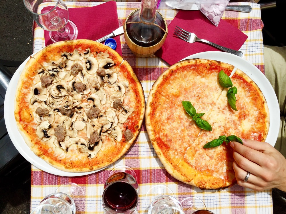 We  ate pizza and drank lunchtime wine in Rome . Like it was going out of style. Like it hasn't been in style there for thousands of years.