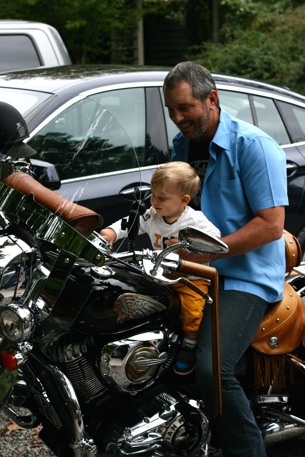 Everett LOVES my dad's Indian motorcycle. He makes the noises. And he always wants to sit on it. But when my dad fires the thing up, he cries.