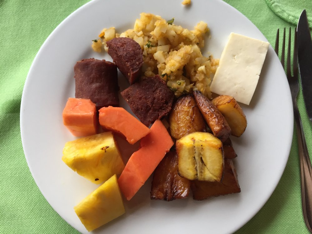 Breakfast: sausage, plantains, queso, fruits
