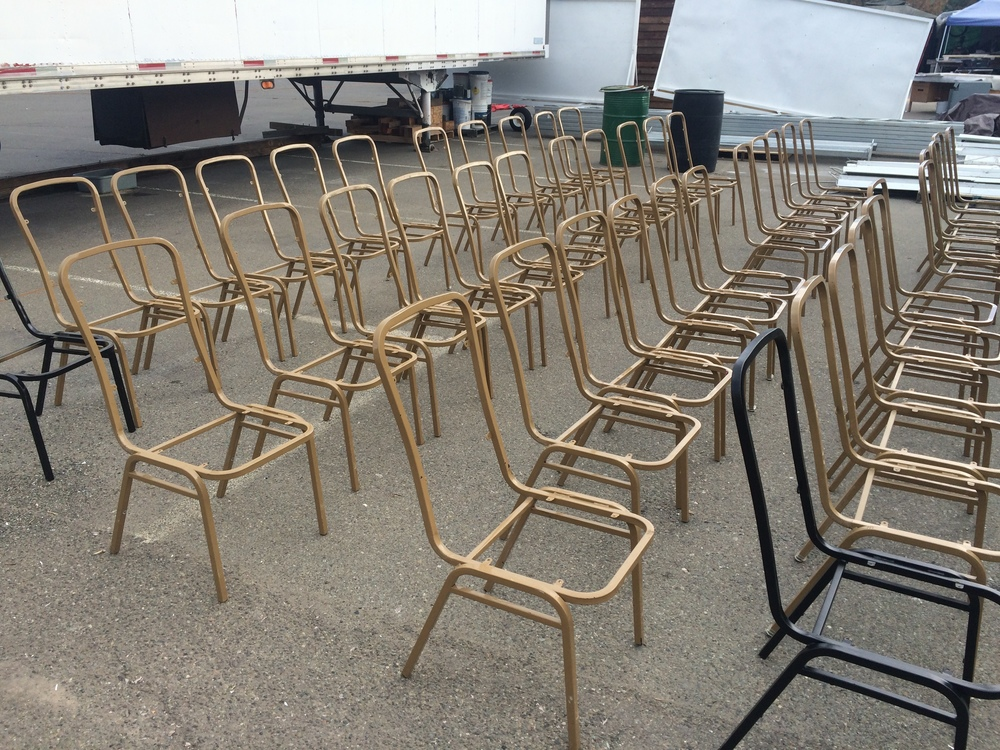 Our fleet of chairs getting prepped for refinishing