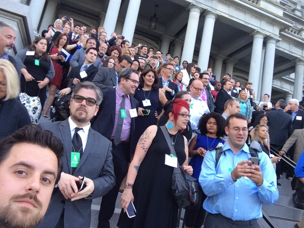 """Chimera Executive Director Dana Woodman standing on the steps of the Eisenhower Building at the White House's """"Nation of Makers"""" meeting last month."""