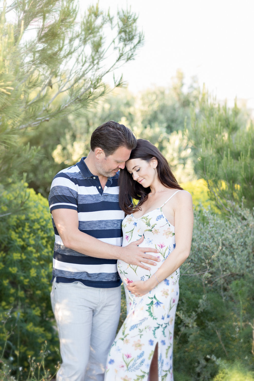 maternity maternity photo shoot golden bay sunset happy couple parents to be expecting glowing pregnant maternity dress malta photographer swedish photographer malta couples malta