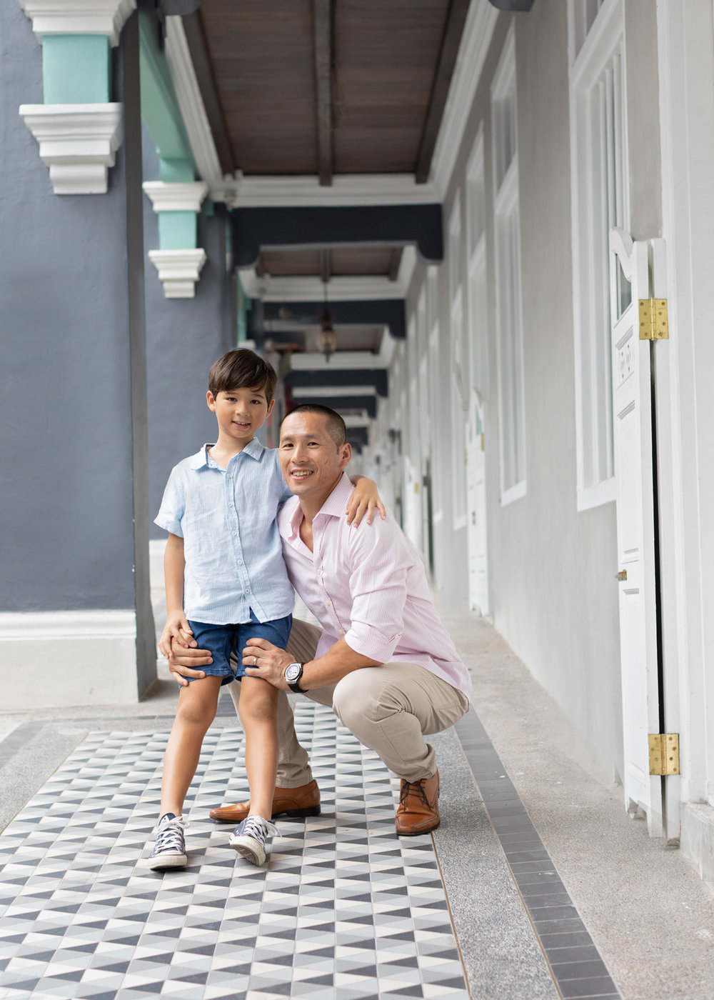 father and son hugging laughing in photo photographed outdoor in singapore