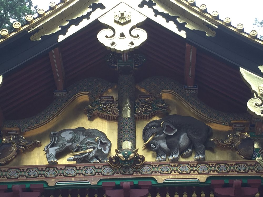 The artist carved the elephant on the right without ever seeing a real one.