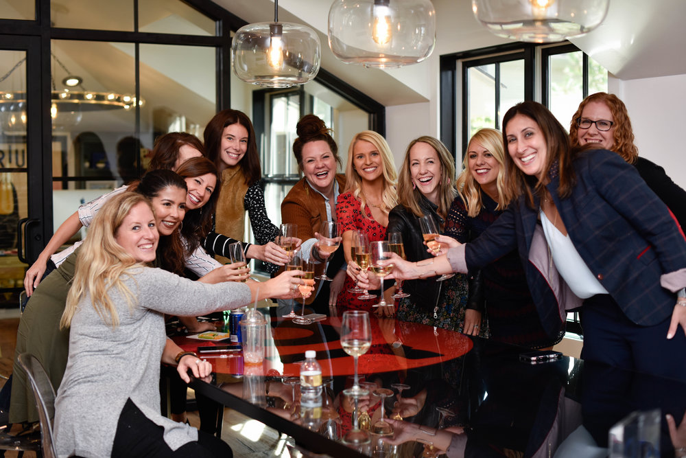 The Approach Marketing Columbus team raises a glass to celebrate the agency's 2018  Columbus Business First  Fast 50 award.
