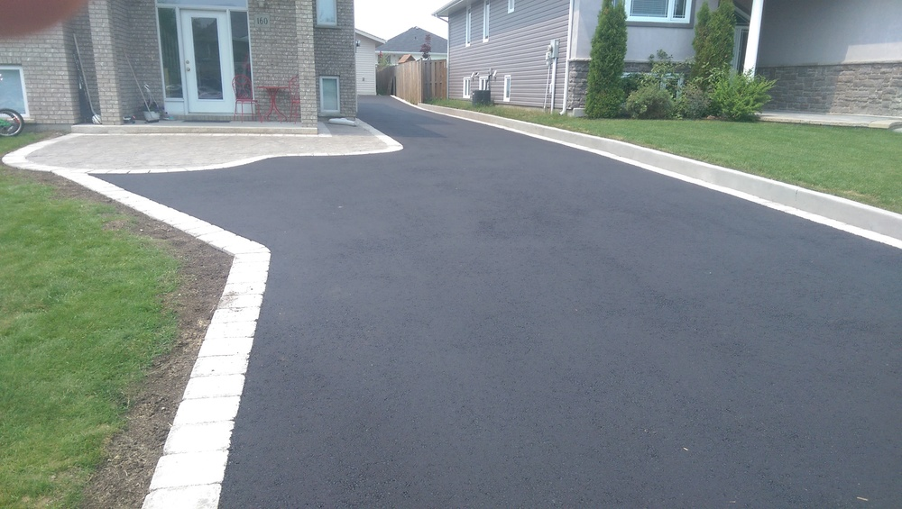 Pour boys stone and concrete thunder bay concrete for Pouring your own concrete driveway