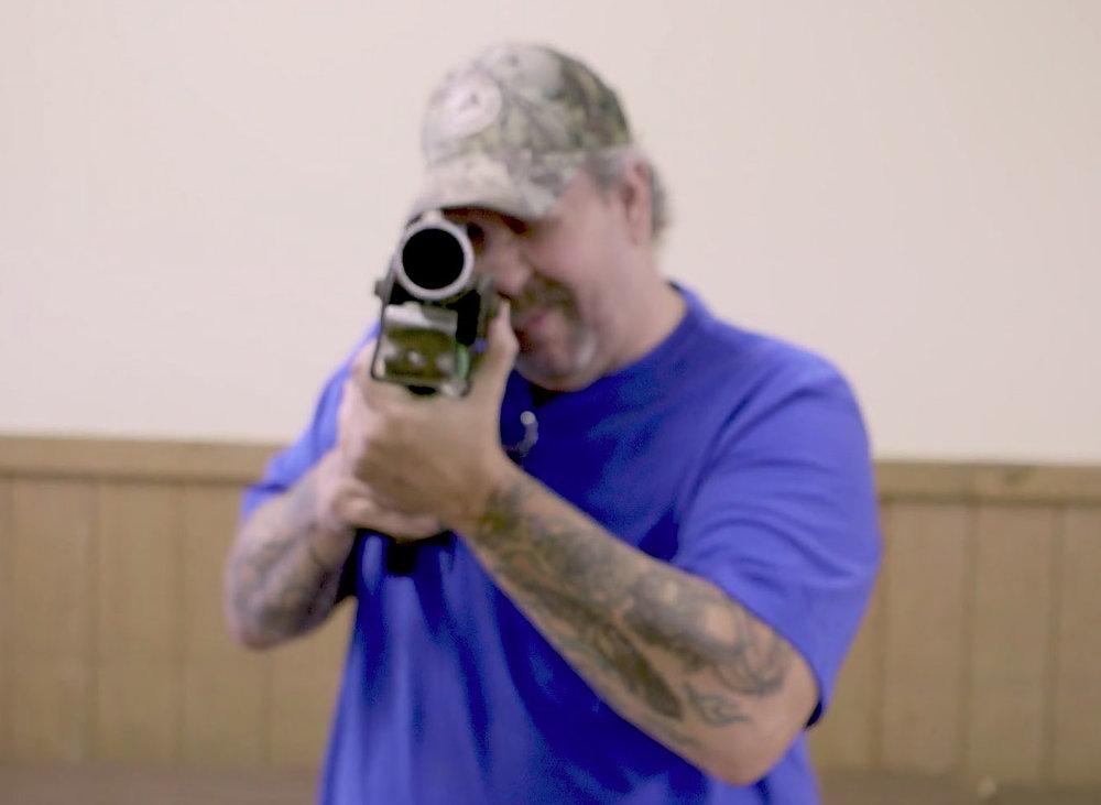 gun show guy aiming.jpg