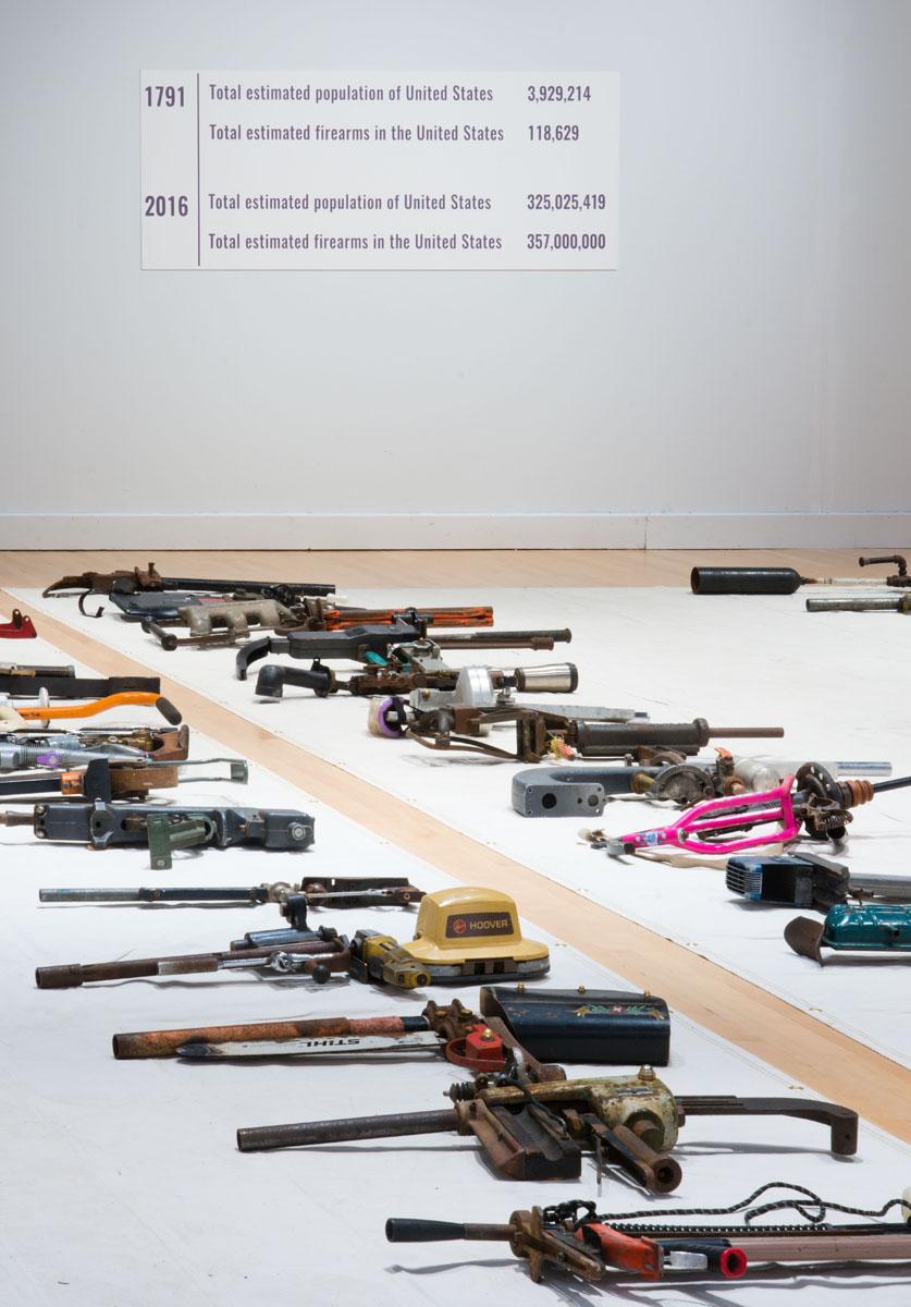 hess gun show umbc stats sign and guns.jpg
