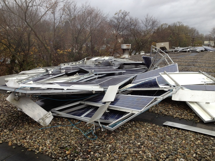 Wind damage from ballasted system