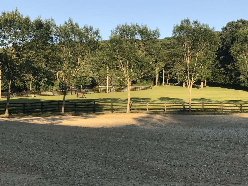 The view from Chester Riding Club's luxurious outdoor gazebo of our newly renovated outdoor ring and spacious turn out paddock.