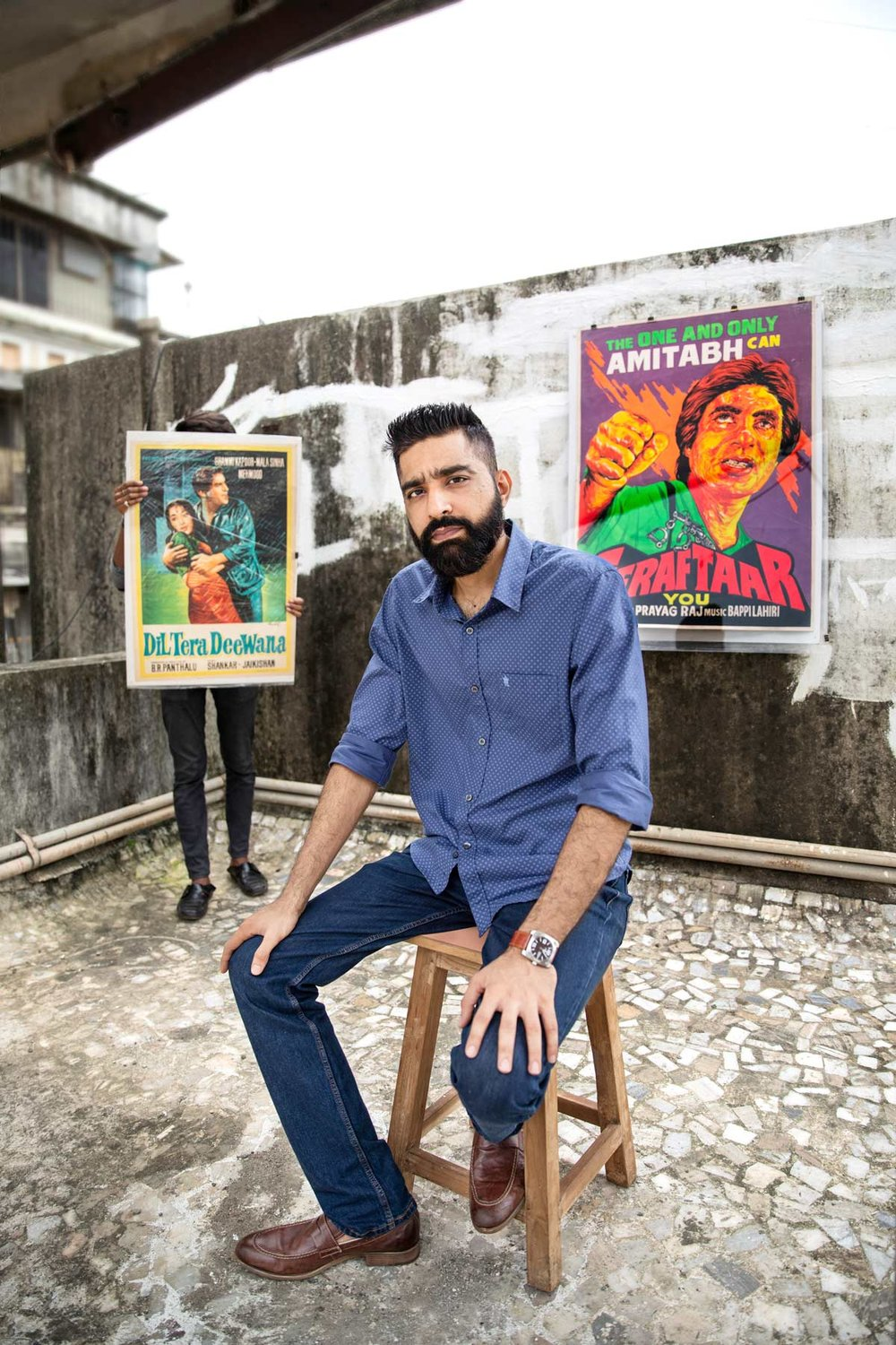 """HINESH JETHWANI FOUNDER, INDIAN HIPPY Before Photoshop and hi-res prints, vivid hand-painted posters were what greeted moviegoers. When the 2008 recession hit India, Jethwani's IT business tanked, and he began tracking down the artists behind these old posters. """"They were close to retiring for good,"""" he recalls. """"Many had given up the paintbrush several years ago and changed careers."""" Indian Hippy, a collective of Hindi movie poster artists, was the result of these conversations. """"We wanted to get the younger generation fascinated and inquisitive about this beautiful hand-painted art form that existed much before the multiplex cinema culture came into vogue,"""" Jethwani says. It's worked, too—over nine years, Indian Hippy has played an important role in upping the ante on vintage movie poster art appreciation. Their repertoire now includes customised portraits as well as elaborate 20kg wall canvases for restaurants. Jethwani is well aware that this may not last forever—only four out of the 12 artists who formed the collective remain. But he hopes that younger artists will pick up the craft and help ensure its survival."""