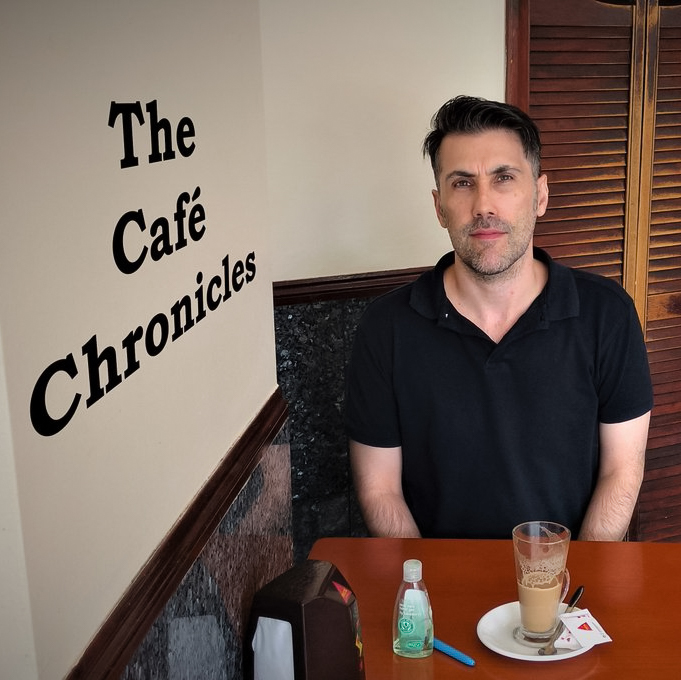 The Cafe Chronicles DRT Apple Podcasts.jpg