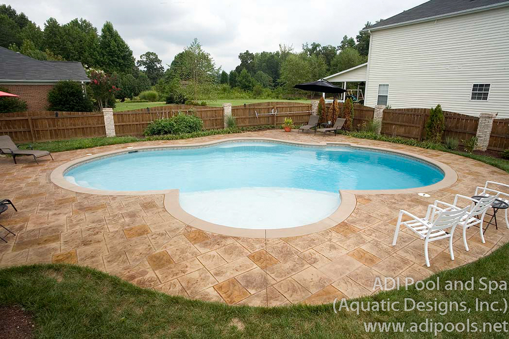 9-thermal-ledge-and-stamped-concrete-pool-deck.jpg