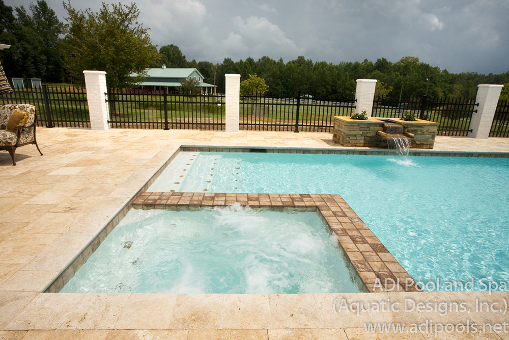 15-pool-and-spa-with-travertine-deck-tile.jpg