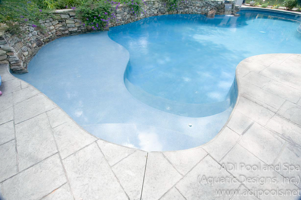 7-pool-with-stamped-concrete-pool-deck.jpg