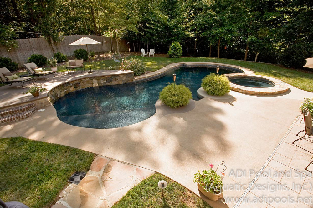 pool-and-spa-combination-with-raised-rock-waterwall.jpg