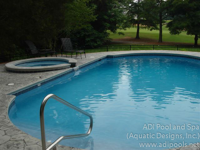 swimming-pool-and-spa-with-stamped-concrete-pool-deck.jpg