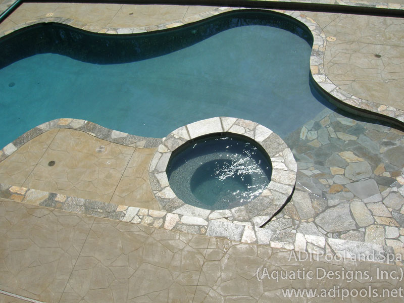 swimming-pool-and-spa-with-stone-beach-entry.jpg