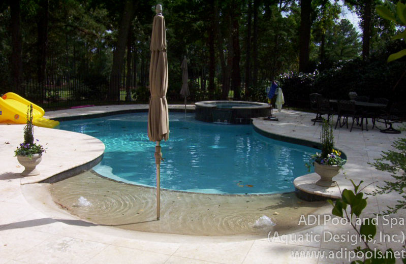 Swimming pools adi pool spa residential and commercial for Pool design with beach entry