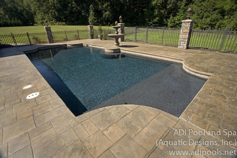 formal-swimming-pool-with-thermal-ledge.jpg