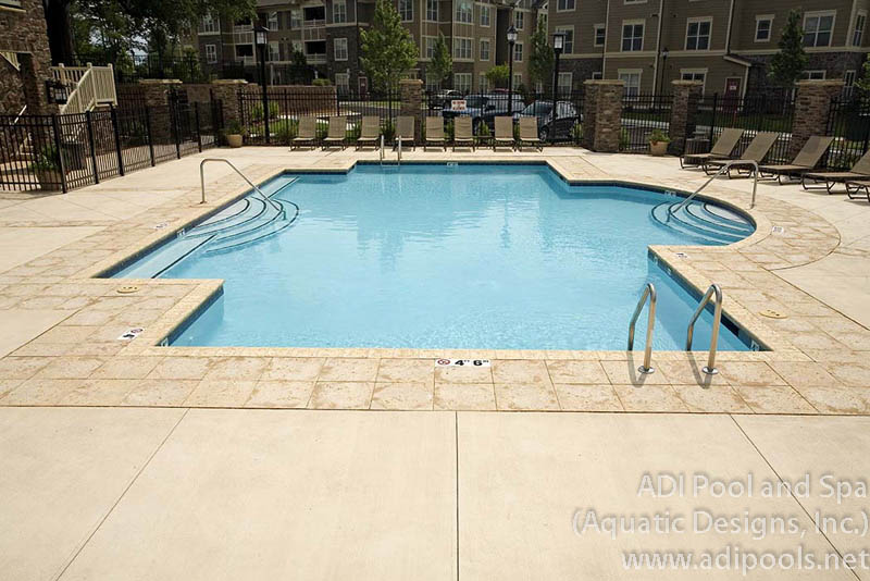 commercial-swimming-pool-with-stone-coping.jpg