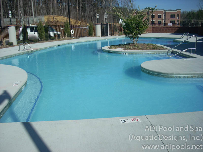 community-pool-with-broom-finish-concrete-deck.jpg