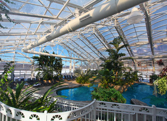 the biosphere pool complex features a heated indoor freeform pool incredible views of the surrounding mountains a 140 foot water slide a grotto like