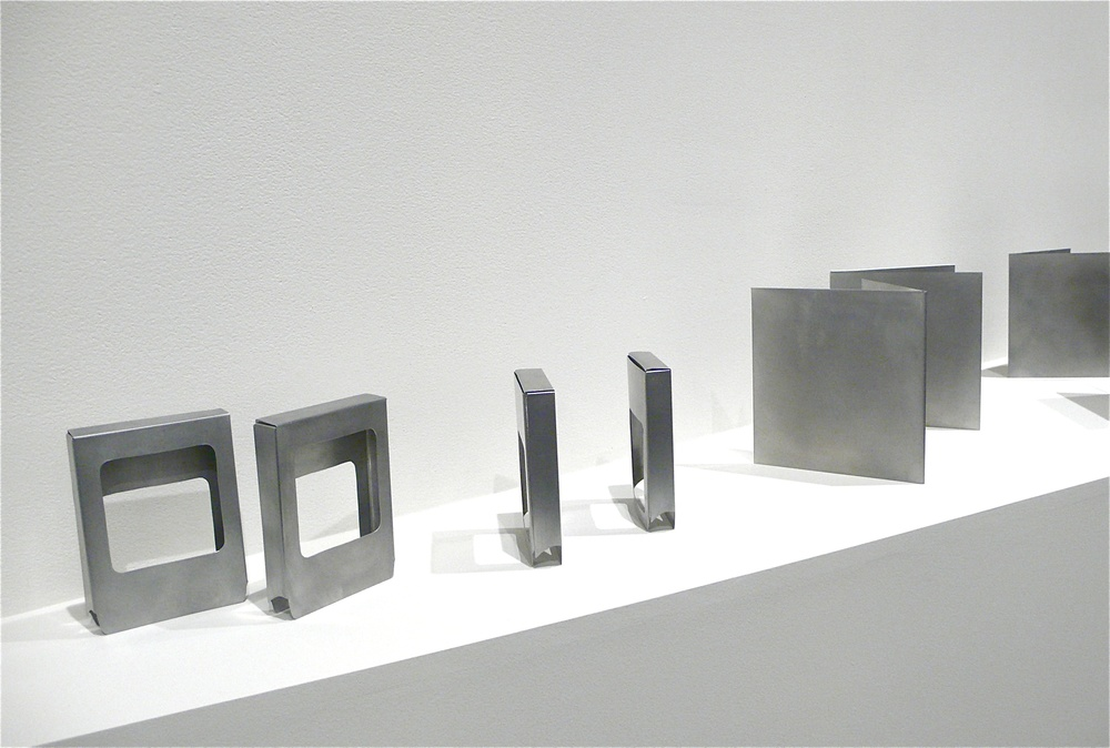 Song Containers, (Installed) -- hand brushed aluminum, to scale. Packaging of: 8Track, Cassette, 45 LP and Standard LP. Edition of 10 sets. 2011