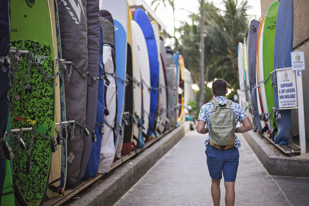 Surfboards line the street walking to Waikiki
