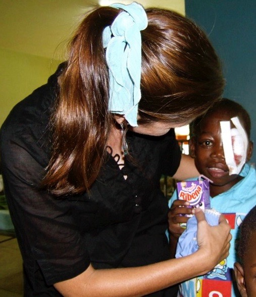 Roxanne Robbins with Okello Dikens at Mulago Hospital in Kampala, Uganda.