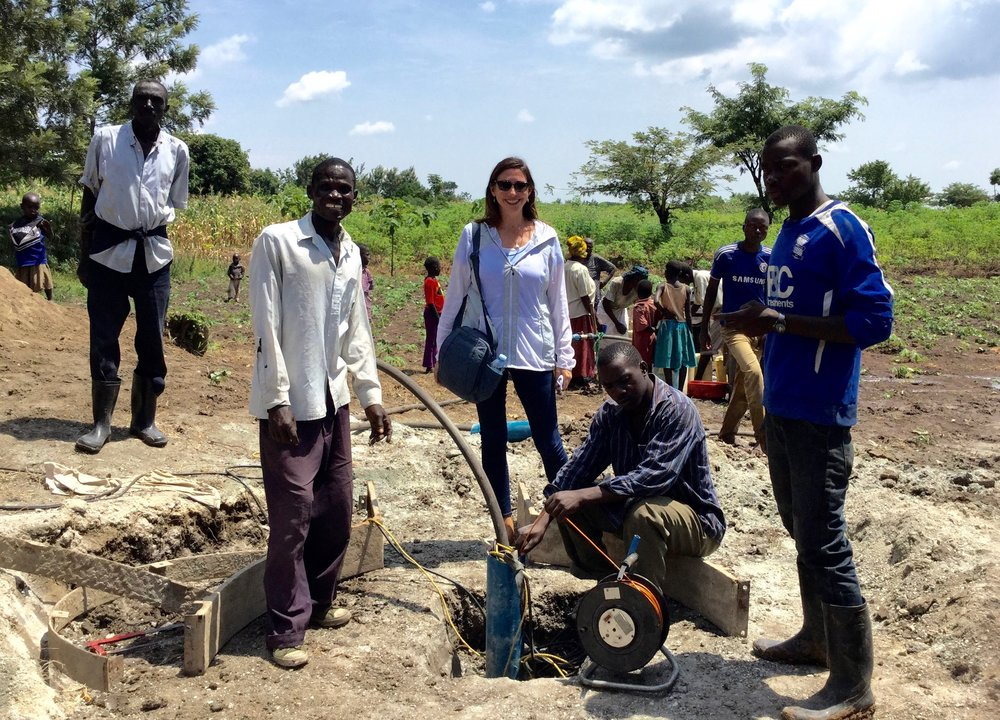 Roxanne Robbins overseeing the installation of a hand pump at well #12 in Busiu, Uganda.