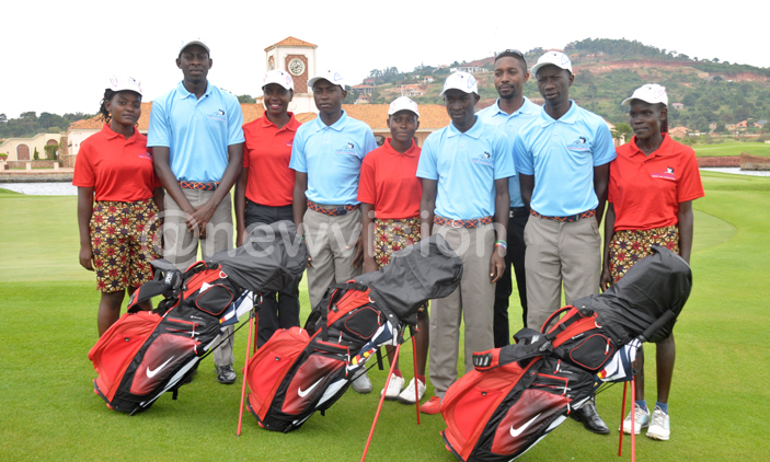 Uganda's girls' and boys' teams pose before they left for the All Africa Golf Championship at the Royal Golf Dar Es Salam Club, Rabat Morocco. L-R: Joan Nampewo, Denis Asaba,Flavia Namakula (coach) Milly Nambooze, David Kamulindwa, Amos Kamya (coach), Edrine Okong and Loyce Bako. PHOTO: Michael Nsubuga