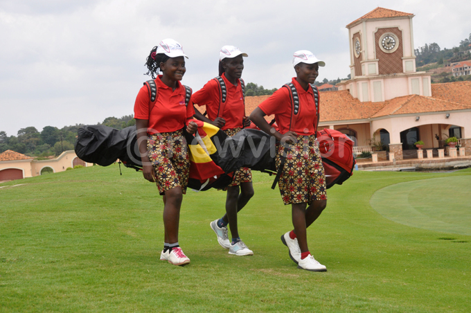 Uganda's girls' team at the Lake Victoria Serena Golf Resort course. L-R: Joan Nampewo, Loyce Bako and Milly Nambooze. PHOTO: Michael Nsubuga