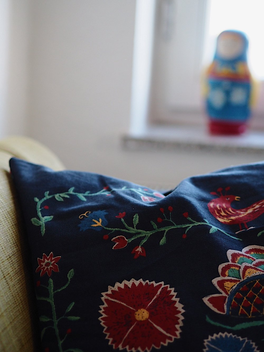 embroidered pillows and matryoshka