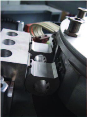 "Above - Rolling link ""dog bone"" used in longer stroke machines is entirely metallic."