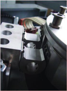 "Above - Rolling link ""dog bone"" used in longer stroke machines is entirely metallic."