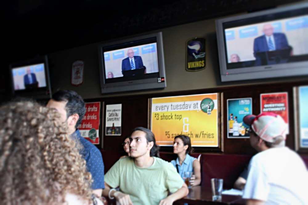 Roberto Cruz Olivera, 23, watches inside Redmond's Ale House as Democratic presidential candidate Bernie Sanders speaks to supporters via live video feed on July 29, 2015.Photo by Justin Bull.
