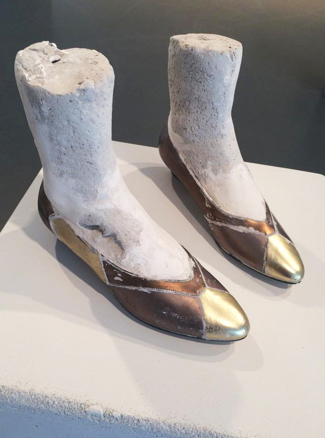 Ashley Lyon   Choir (gold),  2010-2014 unfired clay, plaster, shoes 12 x 12 x 12 inches