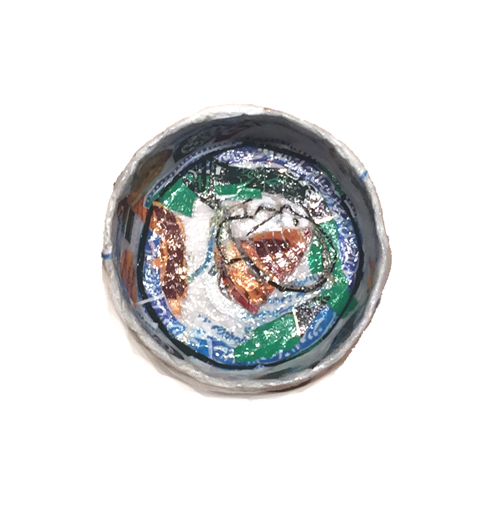 Michael Rakowitz   May The Obdurate Foe Not Stay in Good Health - Painted ceramic bowl, Bab Sharqi (Damascus) , 2016 Syrian and other Middle Eastern packaging and newspapers, glue 1.97 x 3.86 inches 5 x 9.8 cm Courtesy of the artist and Jane Lombard Gallery, NY