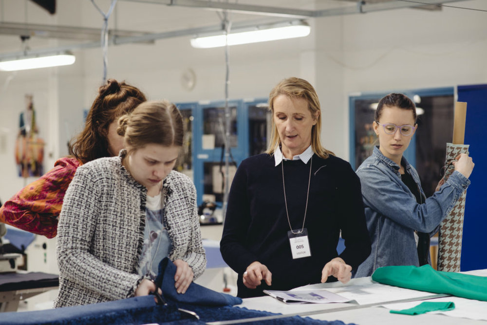 Lucy Orta and London College of Fashion students at a banner making workshop at HM Prison Downview. Photo by Michelle Marshall.