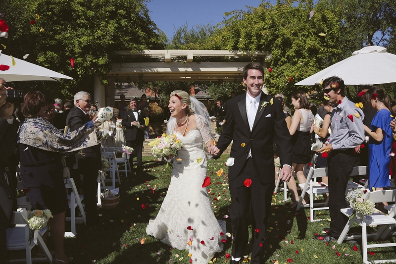 The guests threw rose petals to the happy couple.