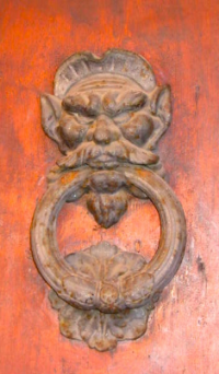 doorknocker, Italy . photo: RRC