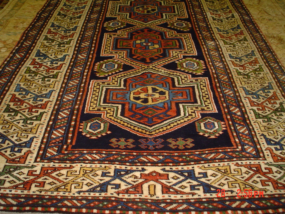 #6) 4 x 6 Afghan Kazak. Nice wool, great price! Actual size is 4 x 5.7 Woven with hand-spun wool.
